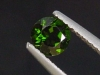 Chrome Diopside 0,54 Ct. round, bottle green, Russia