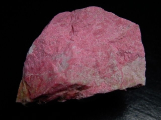 Thulite specimen 50 mm fine raspberry red - Lom, Norway